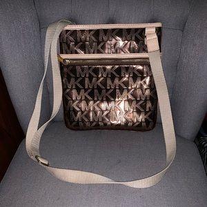 Metallic Michael Kors crossbody bag.
